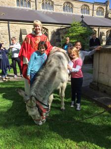 children and happy donkey