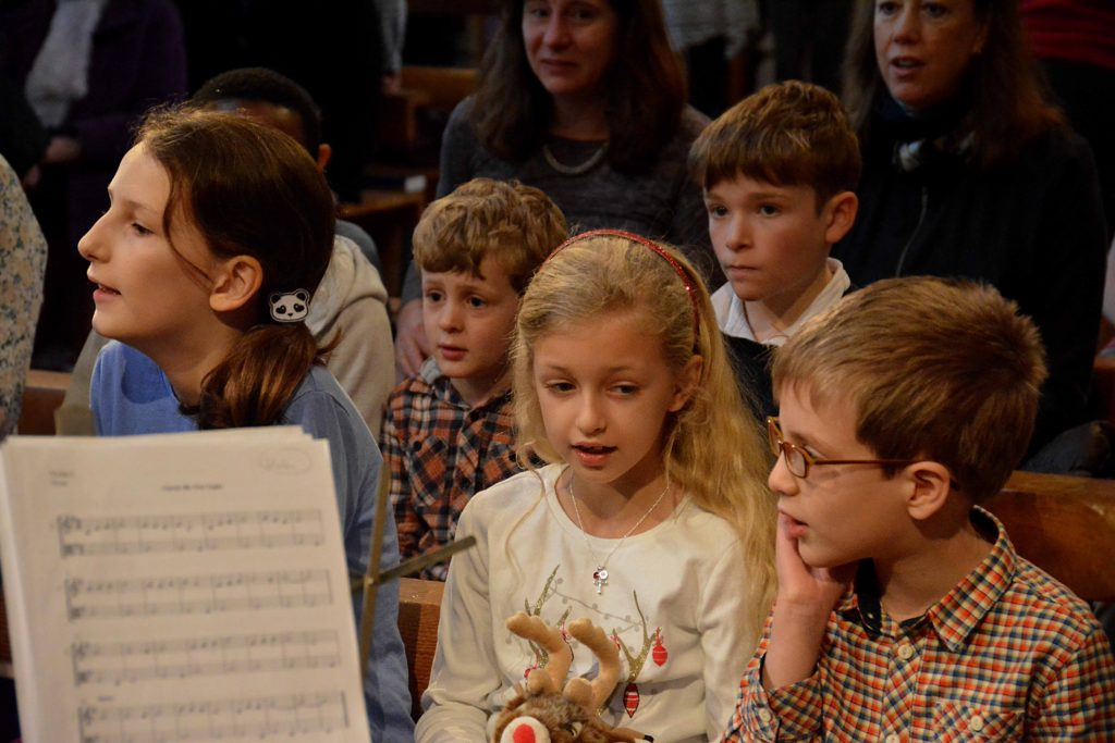 Children's choir rehearse